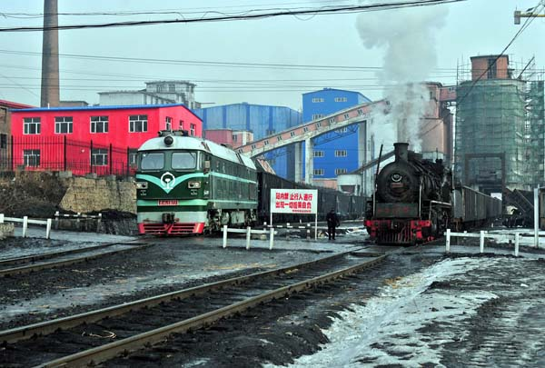 Lishu with their new diesel and the last remaining steam locomtive.