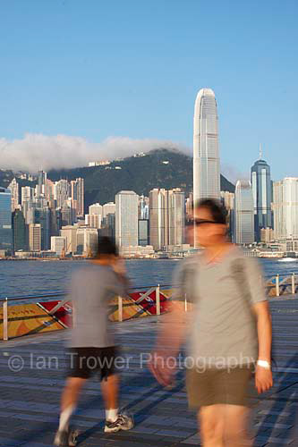 Early Morning Joggers On Kowloon Waterfront