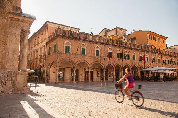 Cyclist in Piazza del Popolo, Ascoli Piceno, Le Marche
