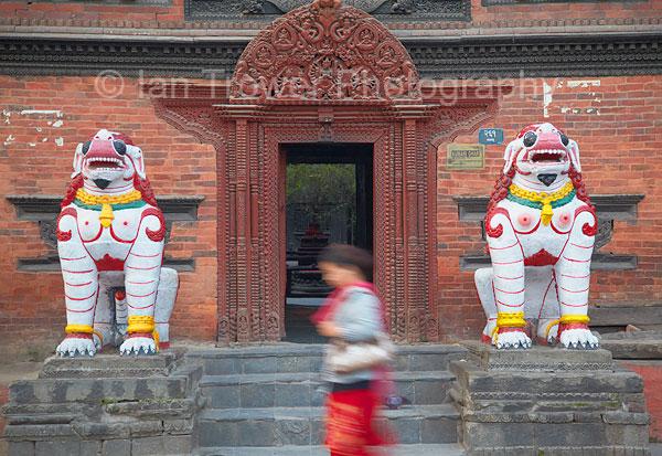 Woman walking past Kumari Bahal, Kathmandu