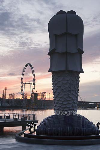 Merlion And Singapore Flyer At Dawn