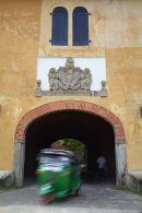 Tuk tuk passing under Old Gate, Galle