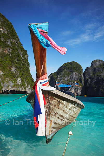 Long Tail Boat Floating On Turquoise Sea, Ko Phi Phi Leh