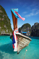 Long Tail Boat Floating On Turquoise Sea, Ko Phi Phi Leh