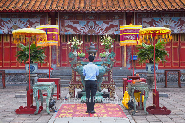 Man praying at Mieu Temple, Citadel, Hue