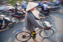 Woman cycling, Hue
