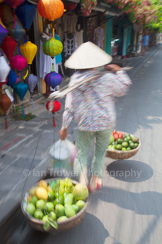 Woman carrying fruit, Hoi An