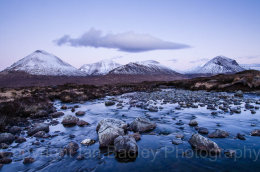 Snow covered Cuillin Mountains over the River Sligachan at twilight, Isle of Skye, Scotland
