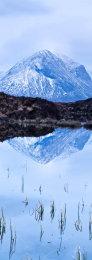 Still Lochen and a snow covered Marsco mountain, Isle of Skye, Scotland