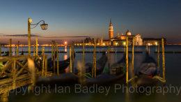 Dawn twilight over gondola and Saint Georgio, Venice, Italy