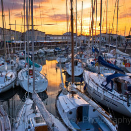 Sunset over the yacht basin at St Martin, Ile de Re, France
