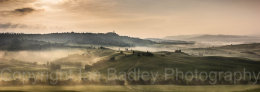 Misty dawn over the UNESCO Val d'Orcia,  below Pienza, Tuscany,  Italy
