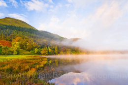 Autumn colours over a misty Loweswater at sunrise, Lake District National Park, Cumbria, England