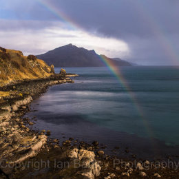 Double rainbow over the sea and mountains on the east coast of the, Isle of Skye, Scotland