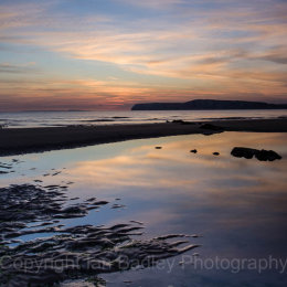 Sunset reflections at Compton Bay, Isle of Wight, England