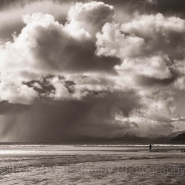 Lone walker on Red Point beach on the north west coast of Scotland