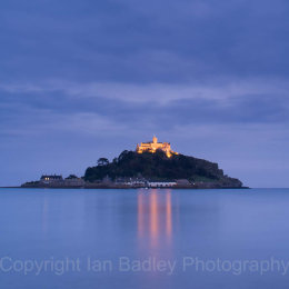 Reflected lights of St Michael's Mount, on a smooth sea, Cornwall, England