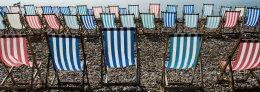 Striped deck chairs at Beer, Devon, England