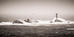 Longship's lighthouse in rough seas off Land's End, Cornwall England