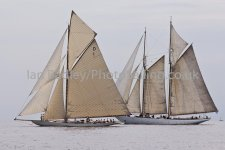 Two classic yachts drifting