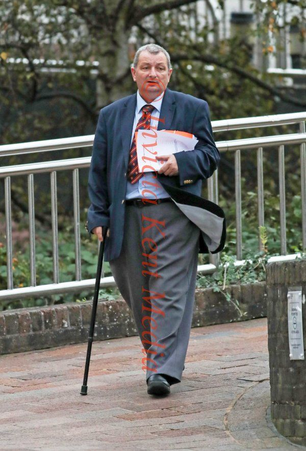 PIC SHOWS:- Former deputy Labour council leader, Robert Woodbridge, 59, who said he could 'only walk with sticks' is exposed as a benefits cheat after officials spot him SAWING and HAMMERING while building a SHED. Seen leaving Maidstone Crown Court.