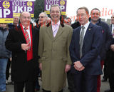 PICS SHOWS  .Nigel Farage andMark Reckless of UKIP welcome two defectors former Tory Councillors from the Medway area of Kent  Vaughan Hewett (Blue Suit Grey Tie Younger of Two) Tom Mason (red Tie Red scarf and Crombie Overcoat)  In Rochester Kent Today  19/3/15