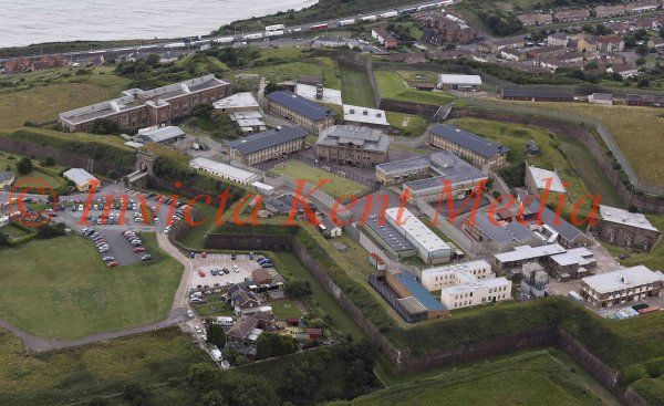 PICS SHOWS ; The immigration Detention Centre in Dover Where the inmates seem to be enjoying a game of Football.