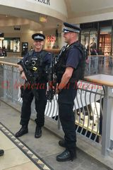 PIC SHOWS; Armed Police Patrol Inside Bluewater in Kent