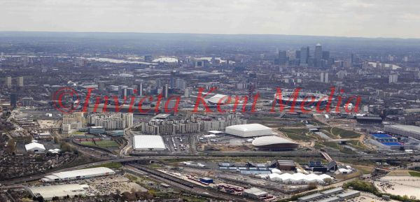 General aerial view of Olympic Park and surrounding area, featuring Millenium Dome and Canary Wharf, London, UK