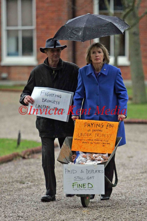 PIC SHOWS ;MAGGIE GEBBETT  PAYING  HER PARKING FIND IN COPPER COINS TO BROMLEY COUNCIL TODAY AT BROMLEY CIVIC CENTRE