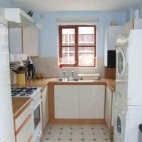 Kitchen with separate washer dryer in 66 Havelock Street.