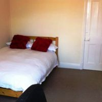 Double pine beds in every bedroom of this Loughborough student accommodation.