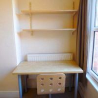 Desk, swivel chair and shelving in every Loughborough Student Accommodation house.