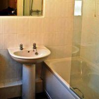 Bathroom with shower over the bath, Loughborough student house.