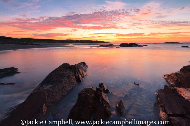Rocky bay sunset