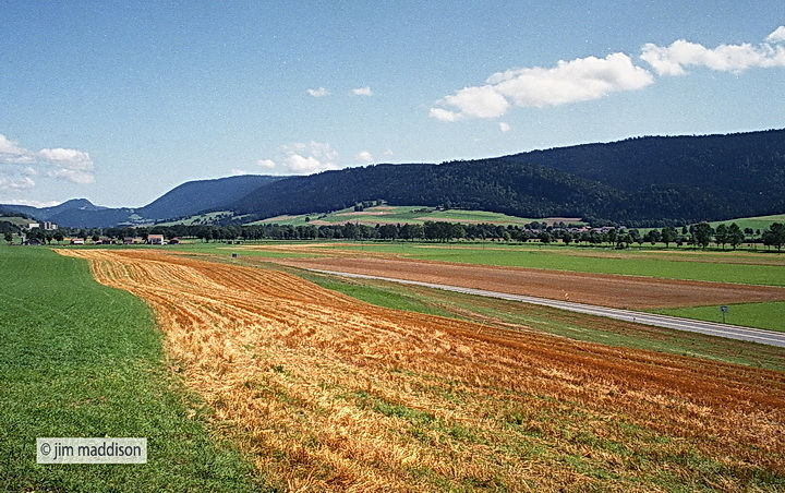 Jim maddison photographs a cut field in switzerland near for Location yverdon suisse