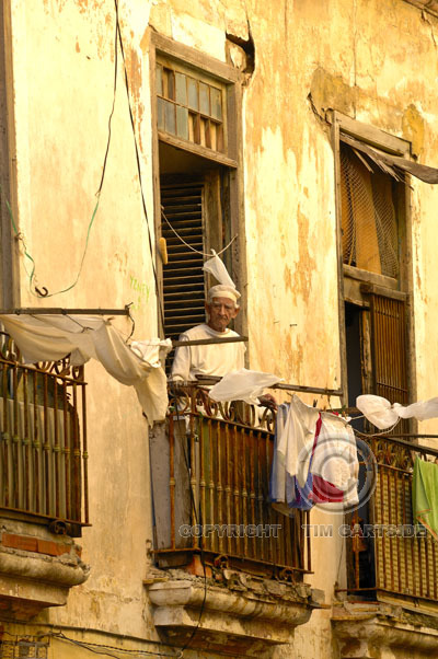 Old man leaning out of window