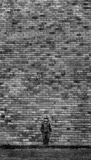 Boy and the brick wall