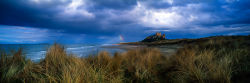 Rainbow and Bamburgh castle