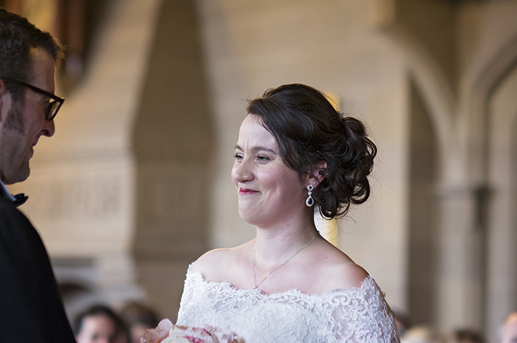 Bride laughs during the ceremony