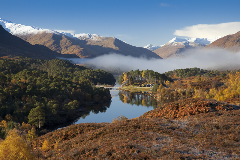 Looking west along Loch Affric to snow topped mountains