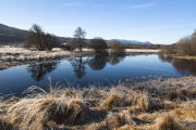 Reflections in the still water of River Moriston, Glen Moriston