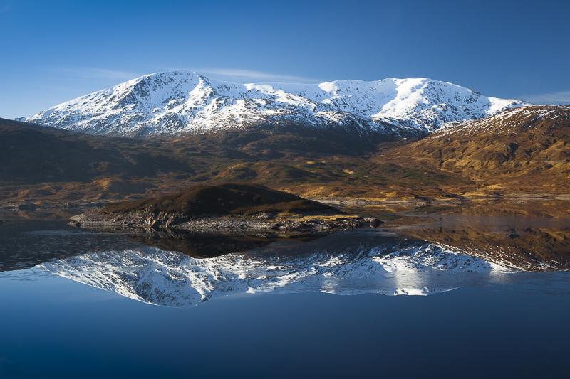 Snow topped Beinn Loinne reflected in Loch Cluanie