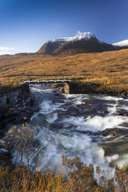 Beinn Alligin overlooks waterfalls on Abhainn Coire Mhic Nobuil, Torridon