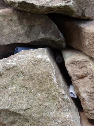 Scrolls of paper with memories left in the gaps between the stones