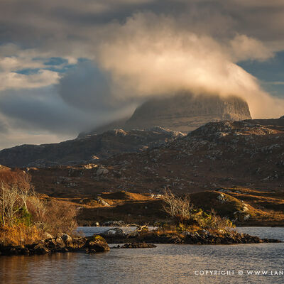 Elphin and surrounding mountains in winter