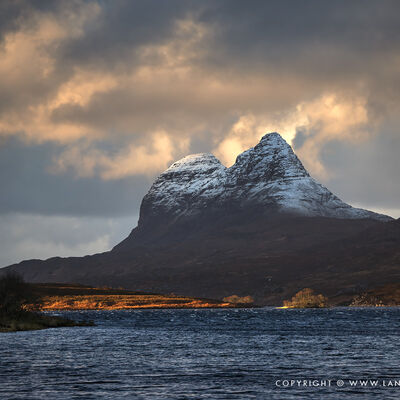 Suilven wrapped in clouds at sunset