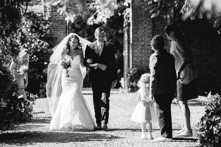 A bride walking to Birtsmorton Court Church before her wedding