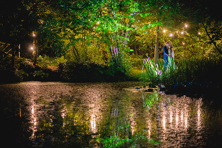 Bride and Groom by the lake at night at the appropriately titled Manor By The Lake in Cheltenham. Manor by the Lake Wedding Photography by Lee Webb