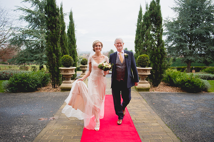 The bride, Nicola, and her father arrive at the magnificent Stanbrook Abbey in Worcestershire for her Christmas wedding. Stanbrook Abbey is a fantastic wedding venue and certainly allows a grand entrance. Stanbrook Abbey wedding photography by Lee Webb